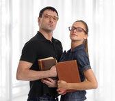 Nerd couple with books — Stock Photo