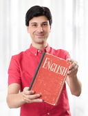 Young man with English Dictionary Book — Stock Photo