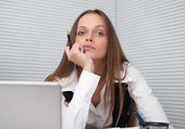Portrait of businesswoman daydreaming inside the office — Stock Photo
