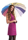 Smiling woman holding an umbrella — Stock Photo