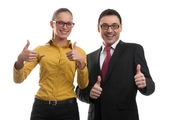 Two businesspeople showing their thumbs up — Stock Photo