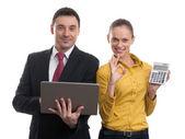 Par de negocios con ordenador portátil y calculadora — Foto de Stock