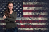 Cute girl over over USA flag background — Stock Photo