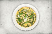Fried eggs with green beans and spinach — Stock Photo