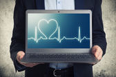 Laptop with ekg on the screen  — Stock Photo