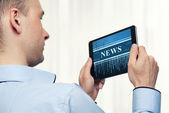 Man Holding Digital Tablet. News concept — Stock Photo