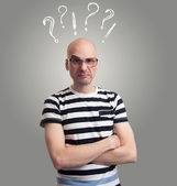 Questions. bald man with silly grimace — Stock Photo