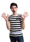 Surprised man with raised hands  — Stock Photo