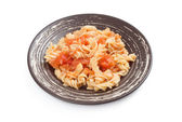 Fusilli pasta with tomato sauce — Stock Photo