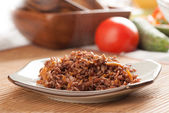 Red rice with onion and carrot — Stockfoto