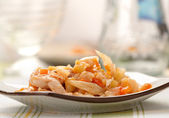 Stewed cabbage with chicken, Onion, and carot — Стоковое фото
