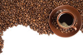 Coffee beans and cup — Stock Photo