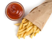 French fries with ketchup on white — Stock Photo