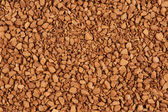 Granules of instant coffee background — Stock Photo