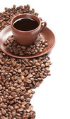Coffee cup and beans on a white background — Stock Photo