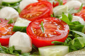 Salad with tomatoes and mozzarella — Stock Photo