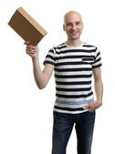 Smiling delivery man holding the box — Stock Photo
