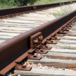 Stock Photo: Iron rusty train railway detail over dark stones rail way