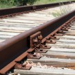 Iron rusty train railway detail over dark stones rail way — Stock Photo #12268650