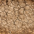 Dry red clay soil texture, natural floor background — Stock Photo