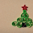 Handmade Christmas tree cut out from paper. Quilling. — Stock Photo #17419437