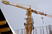 Construction crane building a house — Stock Photo