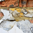 Stock Photo: Old painted brick wall fragment