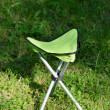 Folds chair in the lawn background — Stock Photo
