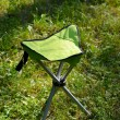 Stock Photo: Folds chair in lawn background