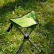 Folds chair in the lawn background — Stock Photo #27164935