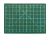 Green cutting mat on a white background — Stock Photo