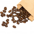 Coffee beans in coffee cup on white background — Stock Photo