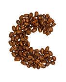 Grains de café, lettres isolé sur fond blanc — Photo