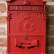 Stock Photo: Vintage red metal mail box on a brick wall