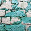 Old brick wall texture background with worn off paint — Stock Photo