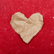 Stock Photo: Torn paper heart on a red background