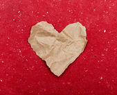 Torn paper heart on a red background — ストック写真