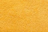 Žlutý ručník jako pozadí pro vaši zprávu — Stock fotografie