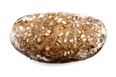Bread with seeds on white top view — Stockfoto