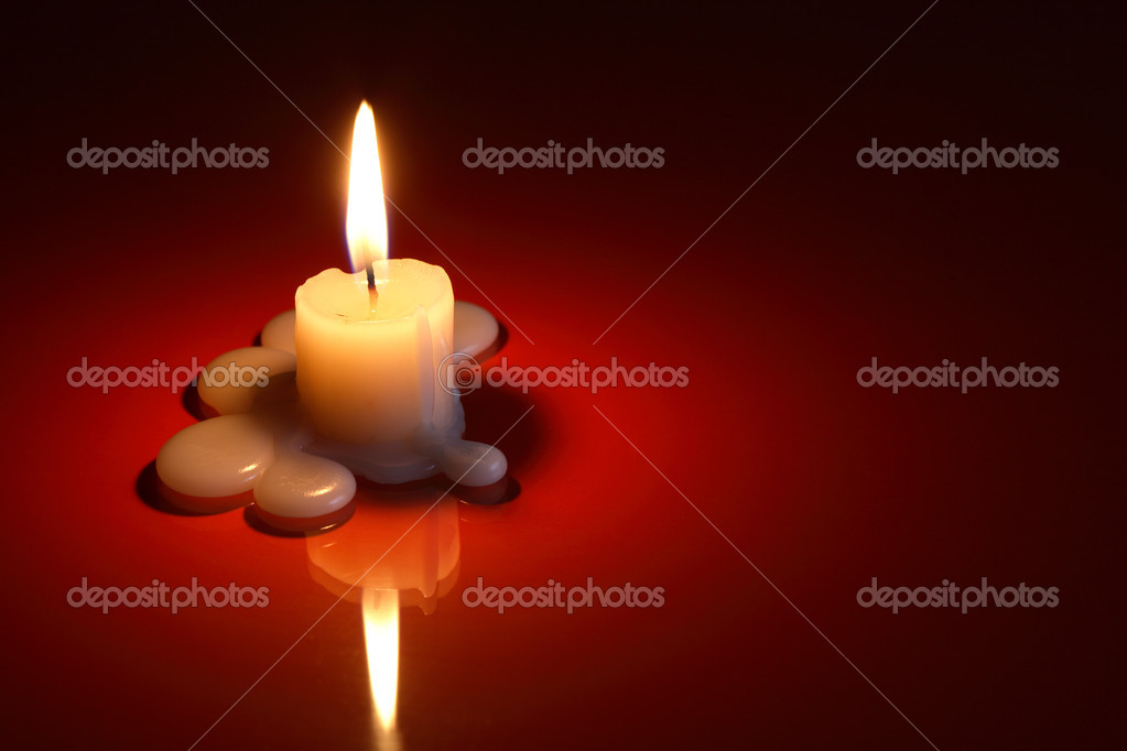 One lighting candle on dark background with free space for text  Foto Stock #13763660