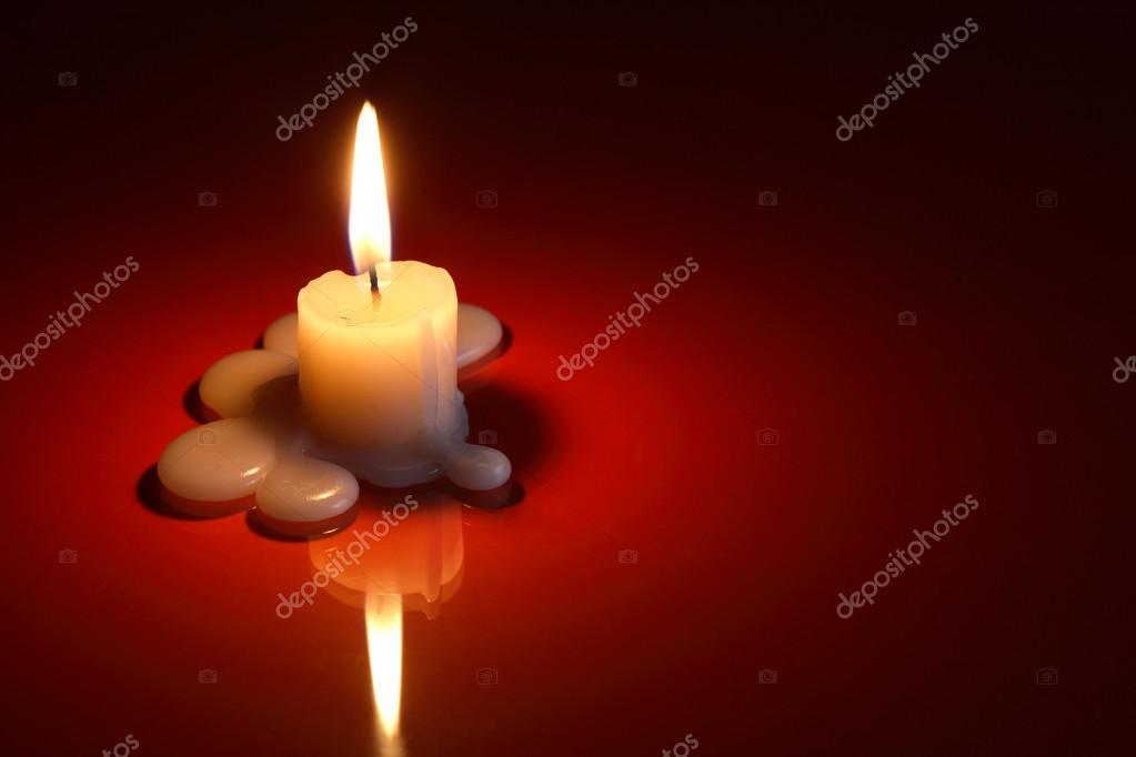 One lighting candle on dark background with free space for text — Foto de Stock   #13763660