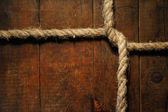 Knotted Rope On Wood — Stock Photo