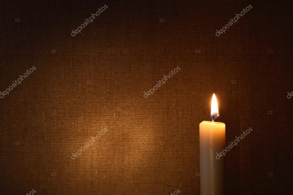 Lighting candle against canvas background with free space for text — Stock Photo #15768747