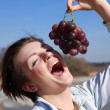 Girl Eating Grapes — Stock Photo
