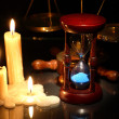 Hourglass And Candles — Stock Photo