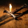 Sword And Candle — Stock Photo