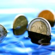Stock Photo: Sinking Coins