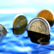 Sinking Coins — Stock Photo