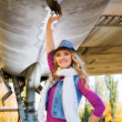 Portrait of attractive woman near aircraft — Foto de Stock