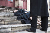 Woman lying on the stairs — Stock Photo